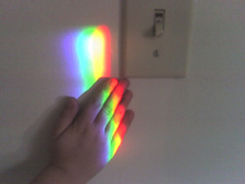 Little hands love to touch the rainbow colors created by a Spectra rainbow sundial on the window sill